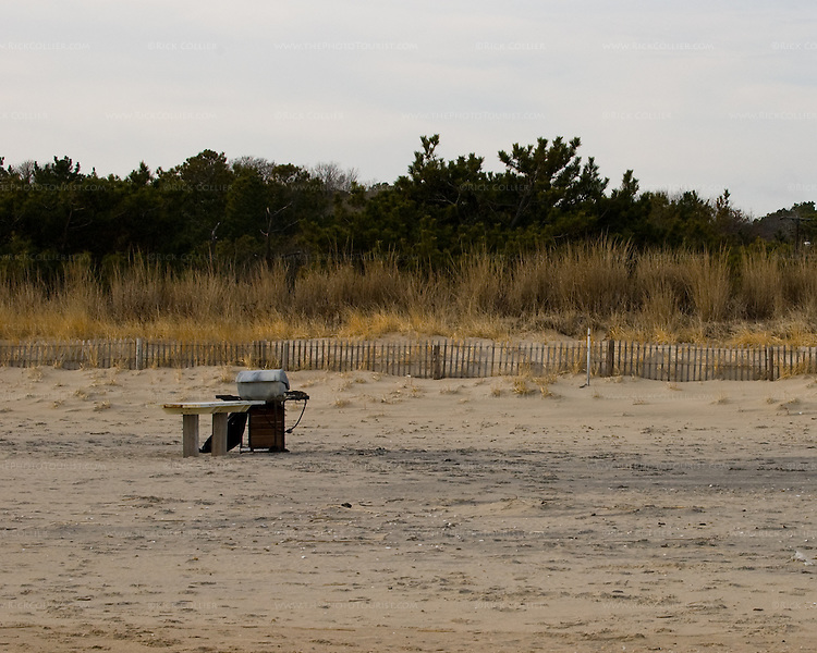 A grill stands on the beach abandoned at the end of the season in Rehoboth Beach, Delaware, USA.
