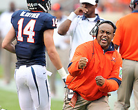 Virginia Cavaliers head coach Mike London reacts to a touchdown during the game against the Southern Miss Golden Eagles at Scott Stadium. Virginia lost  30-24. (Photo/Andrew Shurtleff)