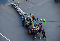 Sep 17, 2016; Concord, NC, USA; Crew members with NHRA top fuel driver Clay Millican during qualifying for the Carolina Nationals at zMax Dragway. Mandatory Credit: Mark J. Rebilas-USA TODAY Sports