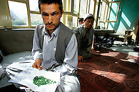 A miner negotiating the sale of 2 month of heavy work at 4000 meters high of dozen of Moudjahidins in the emeralds Panshir Valley of AfghanistanAfghanistan.One of the Khenj more powerful men is Abdul Qayum, a taxman hired by the Northern Alliance to reap 10% of any sale made by the emerald miners.