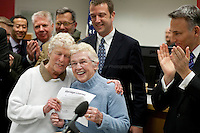 Shortly after midnight, December 6th, 2012, King County Executive Dow Constantine, right, began to issue marriage licenses to same-sex couples in Seattle. First in line are Jane Abbott Lighty, left, and Pete-e Petersen, who have been together for 35 years. Constantine began issuing the licenses immediately upon certification of the November election that passed Referendum 74.  Jane: ?To have our 35 year loving relationship publicly honored and celebrated and have this be a legal marriage means everything to both of us.?