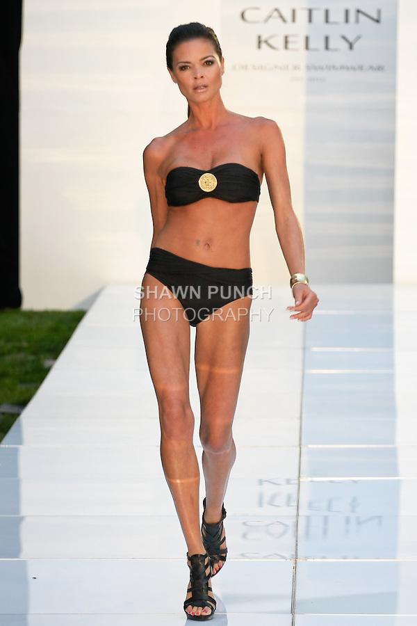 Model walks runway in a medallion front convertible bandeau with convertible bottom swimsuit from the Caitlin Kelley 2013 collection, on the Solarium Rooftop at 2 Gold Street; June 6, 2012.