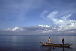 Men fishing on Lake Kivu, a volcanic lake on the Rwandan border with the Central Democratic Republic of Congo (CAR)