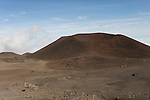 Mauna Kea, Big Island of Hawaii, Hawaii; a cinder cone alongside the road leading up tot the summit of the Mauna Kea Observatories (MKO), currently there are 13 independent multi-national astronomical research facilities located on the summit. Mauna Kea's altitude and isolation in the middle of the Pacific ocean make it an ideal location for astronomical observation.