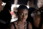JOHANNESBURG, SOUTH AFRICA - MARCH 26: Angolan Model Cael Cash waits for make-up backstage before a fashion show at the South African fashion week on March 26, 2010, Turbine Hall in central Johannesburg, South Africa. Buyers and celebrities watched the 3 day fashion week, a biannual event. (Photo by Per-Anders Pettersson)
