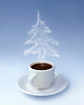 Cup of steaming aromatic black hot coffee with a Christmas-tree shaped steam. The steam is a realistic computer graphic effect. Isoltaed silhouette on gray gradient background. Christmas eve conceptual still life photo-illustration.