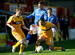 Motherwell v St Johnstone....28.04.12   SPL.Marcus Haber is closed down by Stevie Hammell and Tim Clancy.Picture by Graeme Hart..Copyright Perthshire Picture Agency.Tel: 01738 623350  Mobile: 07990 594431