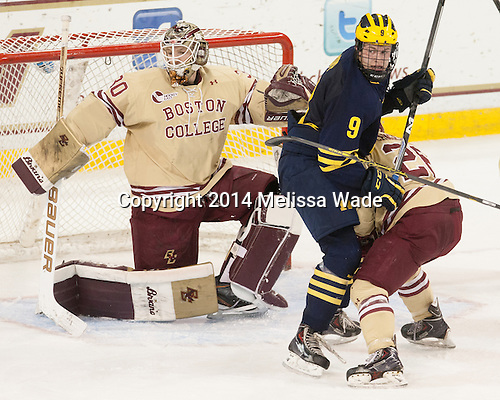 Thatcher Demko (BC - 30), Andrew Copp (Michigan - 9), Austin Cangelosi (BC - 26) - The Boston College Eagles defeated the visiting University of Michigan Wolverines 5-1 (EN) on Saturday, December 13, 2014, at Kelley Rink in Conte Forum in Chestnut Hill, Massachusetts.