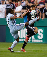 Christian Castillo (12) of D.C. United has the ball cleared away from him by Marvell Wynne (22) of the Colorado Rapids at RFK Stadium in Washington, DC.  The Colorado Rapids defeated D.C. United, 1-0.