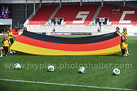The German National flag is unveiled before the UEFA Womens U19 Semi-Final at Parc y Scarlets Wednesday 28th August 2013. All images are the copyright of Jeff Thomas Photography-www.jaypics.photoshelter.com-07837 386244-Any use of images must be authorised by the copyright owner.
