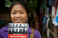 Girl vendor selling Books on Pol Pot at Ta Prohm, Siem Reap Cambodia