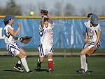 An Olentangy pop fly goes off of Marysville center fielder Darik Parker's (3) glove as left fielder Kadie Sepeda (34) and short stop Heather Halola (6) converge Friday April 17, 2009 at Marysville.(Jodi Miller/ThisWeek)