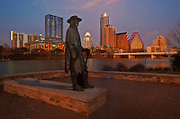 Famous Austin Landmark Stevie Ray Vaughan Statue inset with Austin Cityscape at Sunset