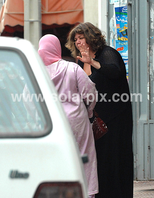 **ALL ROUND EXCLUSIVE PICTURES FROM SOLARPIX.COM**                                             **WORLDWIDE SYNDICATION RIGHTS**                                                                                    Caption: Eastenders actor Cheryl Fergison(Heather Trott) with her boyfriend (fiance) Yassin Al-Jermoni who lives with his elderly parents in Agadir, Morocco.Cheryl is visiting Yassine with her 12-year old son, Alex, by her ex-husband Jamshed Saddiqi                                                                              This pic:  Cheryl Fergison with Yassins family visting a hairdressers in Agadir;Cheryl was dropped off and picked up by Yassin                                                                                          JOB REF: 13368       CS1       DATE: 17.05.2011                                                           **MUST CREDIT SOLARPIX.COM OR DOUBLE FEE WILL BE CHARGED**                                                                      **MUST AGREE FEE BEFORE ONLINE USAGE**                               **CALL US ON: +34 952 811 768 or LOW RATE FROM UK 0844 617 7637**