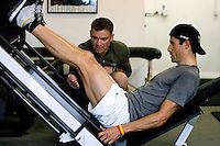 Discovery Channel Pro Cycling Team racer George Hincapie works out under the guidance of trainer Chris Kelly at Peak Performance Adventure Gym. Long successful in the European classics, in addition to being Lance Armstrong's right hand man on the team, Hincapie took his first Tour de France stage win in 2005.<br />