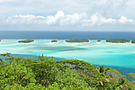 The barrier reef protecting the island of Bora Bora creates a lagoon filled with beautiful turquoise water making for a perfect tropical paradise.