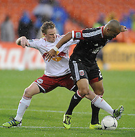 D.C. United forward Maicon Santos (29) goes against New York Red Bulls midfielder Dax McCarty (11) D.C. United defeated The New York Red Bulls 4-1 at RFK Stadium, Sunday April 22, 2012.