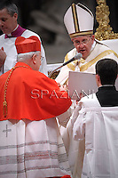 Italian cardinal Gualtiero Bassetti receives his beret as he is being appointed cardinal by Pope Francis  at the consistory in the St. Peter's Basilica at the Vatican on February 22, 2014.