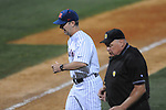 Ole Miss Head Coach Mike Bianco (5) talks to home plate umpire Tony Maners after visiting the mound at Oxford-University Stadium in Oxford, Miss. on Friday, March 18, 2011. Ole Miss won 4-0. The Rebels are 15-4 on the season and 1-0 in SEC play.  (AP Photo/Oxford Eagle, Bruce Newman)