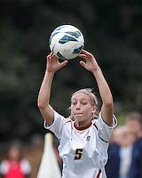 Boston College midfielder Lauren Bernard (5) throw in.   University of North Carolina (blue) defeated Boston College (white), 1-0, at Newton Campus Field, on October 13, 2013.