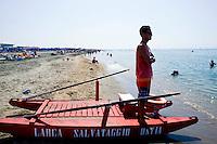 Roma 16 Luglio 2013<br /> Il bagnino dello stabilimento balneare &ldquo;L&rsquo;Arca&rdquo; di Ostia, controlla i bagnanti in mare<br /> The lifeguard bathing establishment &quot;The Ark&quot;  in Ostia, check out the bathers in the sea