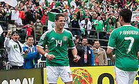 Javier Hernandez (14) celebrates his goal with Pablo Barrera (7) who provided the assist. Mexico defeated Paraguay 3-1 at the Oakland Coliseum in Oakland, California on March 26th, 2011.