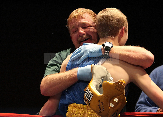 Jeff Neal of Shamrock boxing hugs his son, Kevin Neal, after he boxed at The Main Event at the Lexington Convention Center in Lexington, Ky., on Friday, November 8, 2013. Photo by Tessa Lighty | Staff