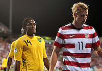 COLUMBUS, OHIO - SEPTEMBER 11, 2012:  Brek Shea (11) of the USA MNT  walks away from a confrontation with Lovel Palmer (14) of  Jamaica during a CONCACAF 2014 World Cup qualifying  match at Crew Stadium, in Columbus, Ohio on September 11. USA won 1-0.