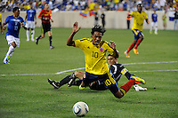 Juan G. Cuadrado (10) of Colombia goes down after a challenge by Honduras  goalkeeper Noel Valladares (18) earning a yellow card. The men's national teams of Colombia (COL) defeated Honduras (HON) 2-0 during an international friendly at Red Bull Arena in Harrison, NJ, on September 03, 2011.