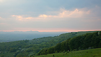 Cleeve common hill at dusk near Cheltenham, Malvern Hills in the distance, Gloucestershire, England