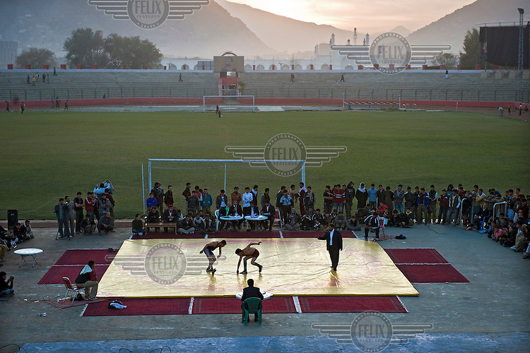 The last fight of the day at the Olympic Stadium in Kabul, where the national wrestling championship is taking place. Young men from across the provinces have come to Kabul to participate.