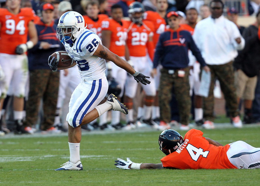 CHARLOTTESVILLE, VA- NOVEMBER 12:  Wide receiver Donovan Varner #26 of the Duke Blue Devils runs past safety Rodney McLeod #4 of the Virginia Cavaliers for a touchdown during the game on November 12, 2011 at Scott Stadium in Charlottesville, Virginia. Virginia defeated Duke 31-21. (Photo by Andrew Shurtleff/Getty Images) *** Local Caption *** Donovan Varner;Rodney McLeod