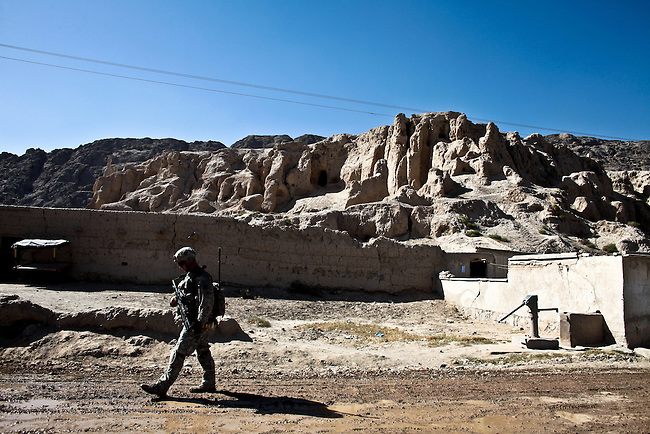 A soldier with Company D, 1st Battalion, 22nd Infantry Regiment walks past the ruins of the ancient citadel in Zor Shar, or the Old City, of Kandahar, Afghanistan. Situated on an extensive plateau and tucked away against the side of a mountain on Kandahar's western side, the bastion and old city date back to the time of Alexander the Great. The citadel was destroyed in 1738 by Nader Shah Afshar of Persia, but thousands of people live in newer structures built among the old mud ruins. Oct. 4, 2010. DREW BROWN/STARS AND STRIPES