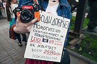 "Moscow, Russia, 19/05/2012..Several thousand artists and opposition activists demonstrate against Vladimir Putin by walking through Moscow transporting their artworks. The protest coincided with Museum Night, when Moscow's museums are open until midnight with special exhibitions and performances..""Good people! Help me as much as you can for a new camera Leica M7 Hermes Edition. I don't have enough, it's only 29990 Euros, please!"""