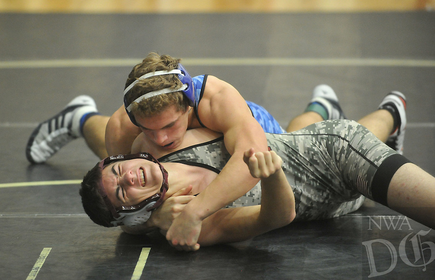 NWA Democrat-Gazette/MICHAEL WOODS &bull; <br /> Christian Brummett from Rogers High School (blue Jersey) competes against  a Logan Rogersville wrestler Saturday, December 19, 2015 in the championship match in the 170 pound division at the Bentonville High School wrestling tournament.