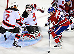 9 January 2010: New Jersey Devils' goaltender Martin Brodeur makes a first period save on left wing forward Mike Cammalleri (13) of the Montreal Canadiens at the Bell Centre in Montreal, Quebec, Canada. The Devils edged out the Canadiens 2-1 in overtime. Mandatory Credit: Ed Wolfstein Photo