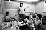 Paul and Linda McCartney Wings Tour 1975.  Paul in discussion in rehearsal dressing room with Wings band members, Jimmy McCulloch and drummer Joe English. Elstree,  London England.