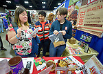 Bekah Forni (right) of Equal Exchange provides samples of fair trade products to an appreciative Shirley McNichol of Texas during the United Methodist Women Assembly in the Kentucky International Convention Center in Louisville, Kentucky, on April 25, 2014.