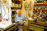 Jean Kazes, master Swiss clockmaker, at his studio in the Carouge neighborhood in Geneva, Switzerland, Europe