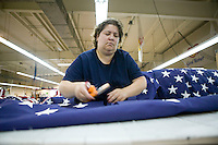 21 June 2005 - Oaks, PA - Karen Hipple separates fields - the starred part of an American flag - at the Annin & Co. flag manufacturing plant in Oaks, PA.