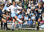 24 November 2007: North Carolina's Meghan Klingenberg shoots the ball past Notre Dame's Julie Scheidler (25). The University of Notre Dame Fighting Irish defeated University of North Carolina Tar Heels 3-2 at Fetzer Field in Chapel Hill, North Carolina in a Third Round NCAA Division I Womens Soccer Tournament game.