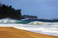 A wave breaks in a perfect circle along the golden sand shoreline of Lumaha'i Beach, Kaua'i.