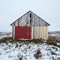 Derelic barn in winter, Lofoten Islands, Norway