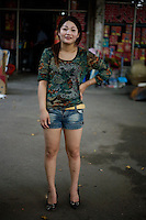 Lijun, a self-described unemployed wanderer, age 21, poses for a portrait in Pukou near Nanjing. Response to 'What does China mean to you?': 'Grand.'  Response to 'What is China's role in the future?': 'I hope that Nanjing of China will get better and better.'