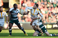 Elliot Daly of Wasps offloads the ball after being tackled. Aviva Premiership match, between Leicester Tigers and Wasps on November 1, 2015 at Welford Road in Leicester, England. Photo by: Patrick Khachfe / Onside Images