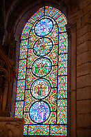 Medieval stained glass window showing the allegories of Saint Paul, (from the Top) Christ between the Church and the Synagogue, Moses, The mill of Saint Paul, The book of the Lions and the sheep. The Gothic Cathedral Basilica of Saint Denis ( Basilique Saint-Denis ) Paris, France. A UNESCO World Heritage Site.