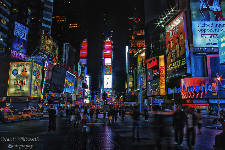 A New York City view of Times Square at night.