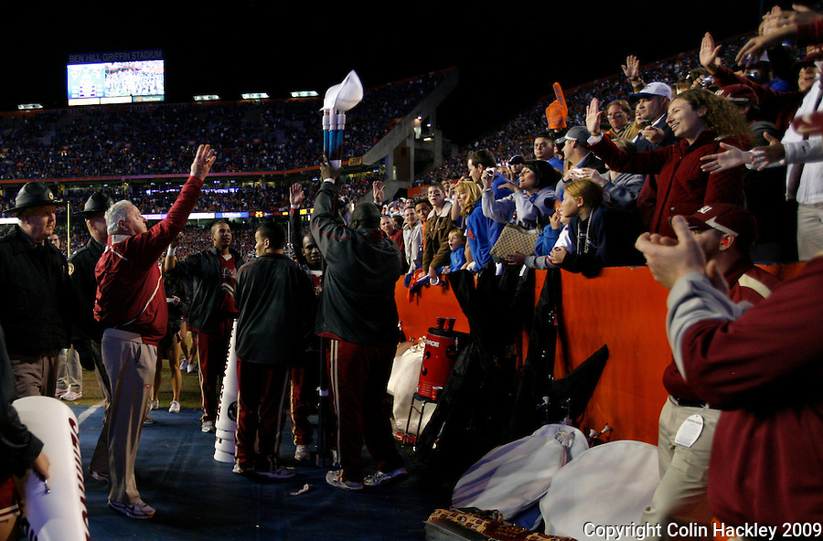 GAINESVILLE, FL 11/28/09-FSU-UF FB09 CH77-Florida State Head Coach Bobby Bowden tosses his hat to the fans after the Florida game Saturday at Florida Field in Gainesville. The Gators beat the Seminoles 37-10..COLIN HACKLEY PHOTO