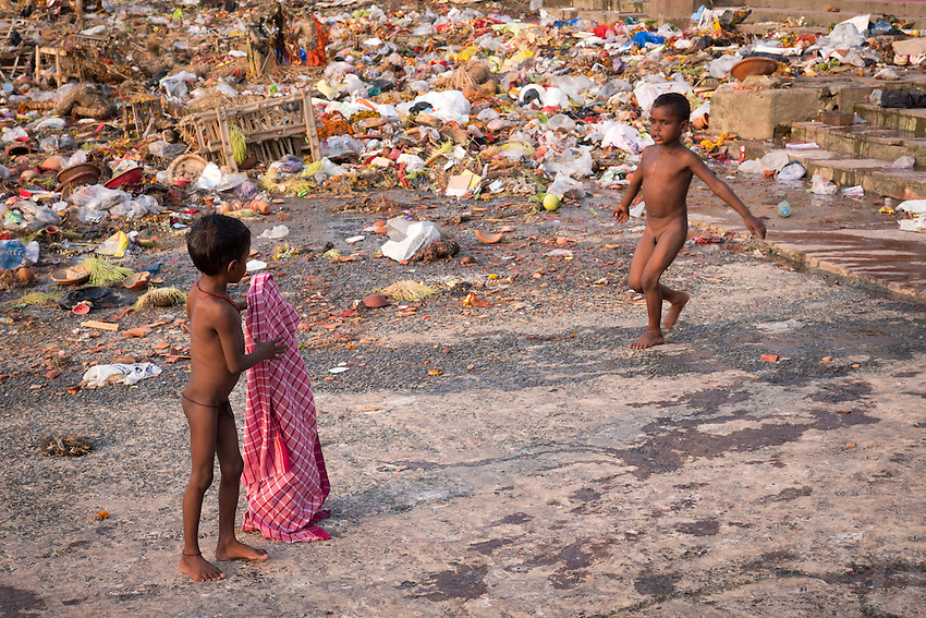 Children playing among the Garbage and Plastic that accumulated at the banks of the Ganges River at the Babu Ghat, an environmental problem. Ganges River Kolkata, India