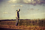 Man standing on the fringe of a wheat field